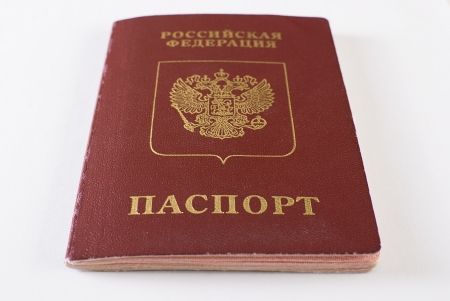 Russian international traveling passport over white background. Not isolated