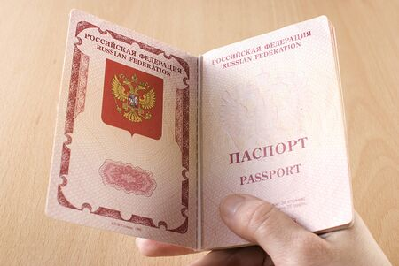 Russian international traveling passport in female hand.  Stock Photo - 11019302