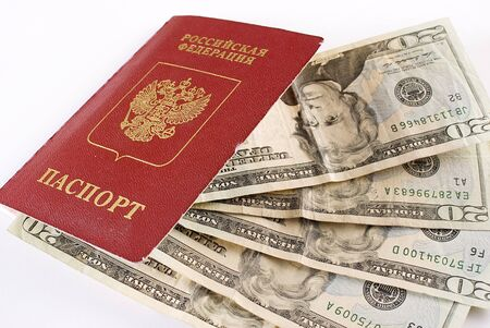 Russian international traveling passport and money over white background. Not isolated. Stock Photo
