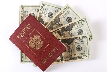 Russian international traveling passport and money over white background. Not isolated. photo