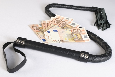 cash crop: Black Single Tail Whip and money on white background. Not isolated.