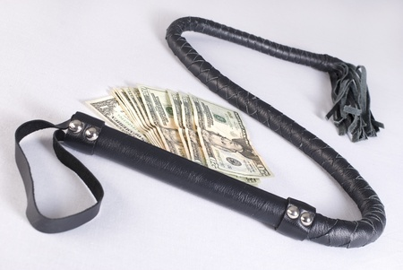 flogging: Black Single Tail Whip and money on white background