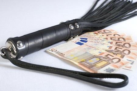 flogging: Strict Black Leather Flogging Whip and money on white background. Not isolated. Stock Photo