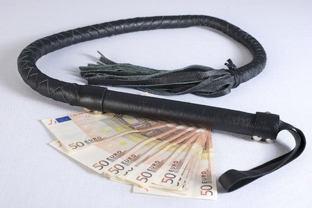 single whip: Black Single Tail whip and moneyon white background. Not isolated.