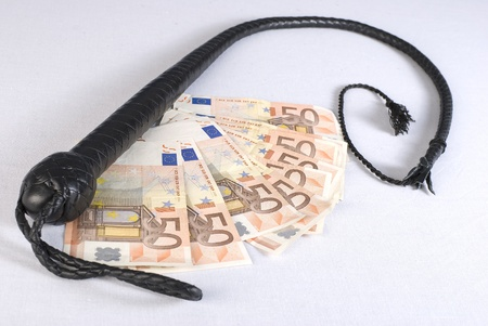 single whip: Black Single Tail whip and money on white background. Not isolated.