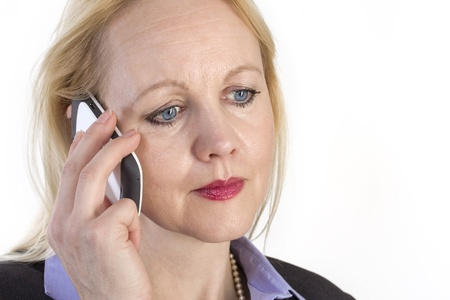 Close-up portrait of an adult beautiful business woman speaking on a phone. Stock Photo