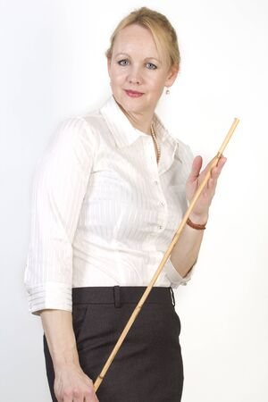 Portrait of an adult beautiful business woman with a cane in her hands.
