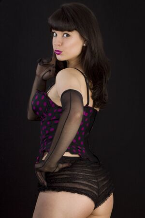 Beautiful Sexy Pin-Up Girl.  over black background. Not isolated.