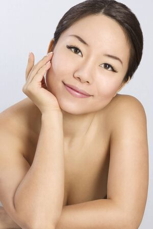 Closeup portrait of Young and Beautiful asian woman. Not isolated. Stock Photo - 12010585