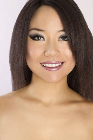 Closeup portrait of Young and Beautiful asian woman. Not isolated.