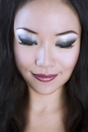 Closeup portrait of Young and Beautiful asian woman. Not isolated.  photo