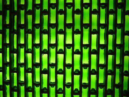 green bottle wall laid as bricks photo