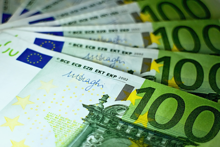 Hundred euro banknotes ready for payment.