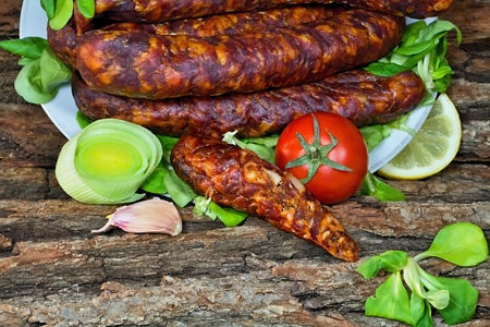 meaty: Tasty smoked sausages with seasoned salad ready for consumption.