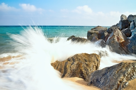 Sea waves hitting the rocky beach at Malgrat de Mar, Spain.