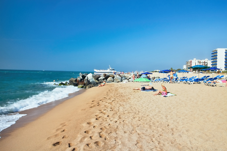 Beach at the Mediterranean Sea in Malgrat de Mar, Spain. Stock Photo