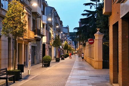 A typical evening alley in the old part of Malgrat de Mar. Stock Photo