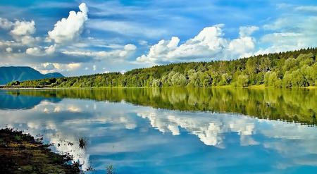 reflective: The bay with a mirror on the water level at the Liptovska Mara dam. Stock Photo