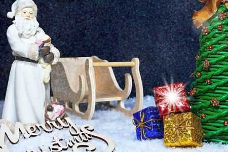 Christmas theme. Santa Claus in Christmas atmosphere with gifts, Christmas tree and snow. Christmas - An extraordinary Christian holiday. Merry Christmas to everyone.