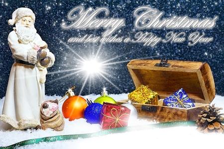 Christmas holidays. Merry Christmas. Christmas theme. Christmas card with Santa Claus, gift box, christmas balls with christmas glow. Stock Photo
