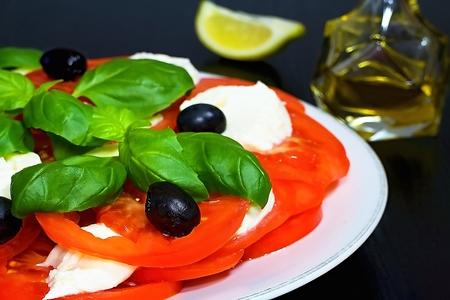 Caprese salad. Italian traditional caprese salad ingredients. Mediterranean food. Italian salad.