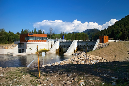 Small hydro power plant on the river Vah in Podturen - Liptovsky Jan. Energy from water. An environmental way of generating electricity. Imagens