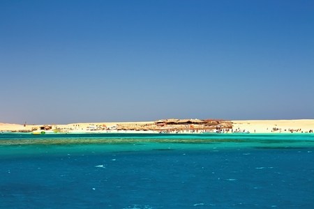 Egypts Giftun Island in the Red Sea with its popular Paradise Beach. Corals and the interesting different color water of the Red Sea.