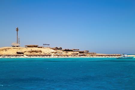 Trip from Egyptian Hughada to Giftun Island. Beautiful beach Malmya. More, sand, parasols, snorkeling and a nice sunny day.