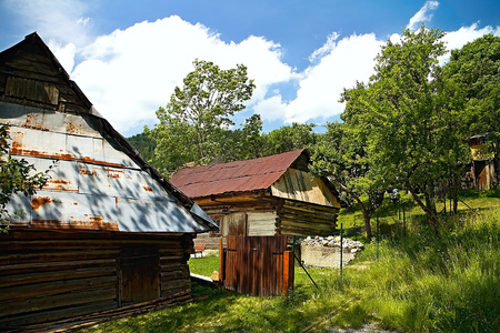 Vlkolinec - mountain village with a folk architecture typical of the Central European type. Wooden houses in the Vlkolinec settlement with front gardens.