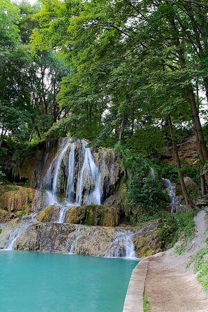 Waterfall Lucky near Liptov village Lucky. Often visited attraction of beautiful part of Slovakia. Imagens - 132065887