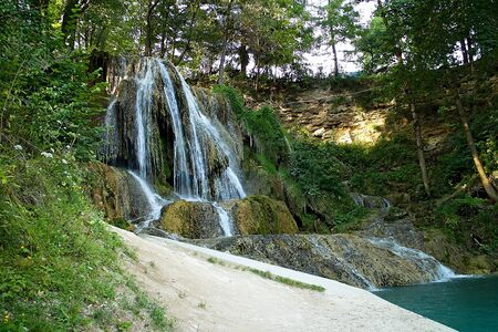 Lucky waterfall, a village with well-known SPA, travertine fields and indispensable. Imagens