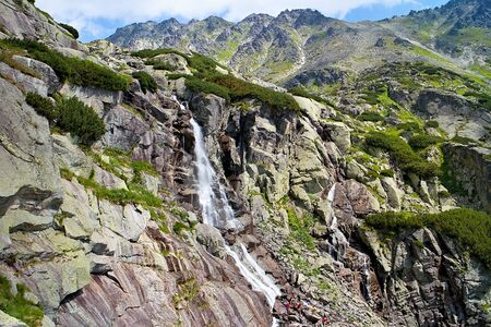 You know this beautiful magical place in the High Tatras. This is the Skok waterfall in Slovakia. Imagens - 132065572
