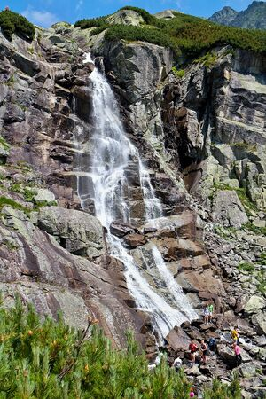 Skok Waterfall in the High Tatras in Slovakia. Imagens - 132065896