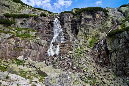 Waterfall Skok in all its glory. The best waterfall in the High Tatras. Imagens - 132065830