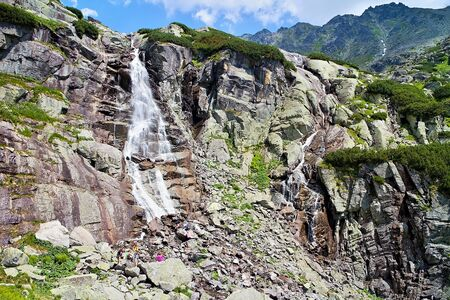 Skok Waterfall and surounding in the High Tatras in Slovakia. Imagens - 132065309
