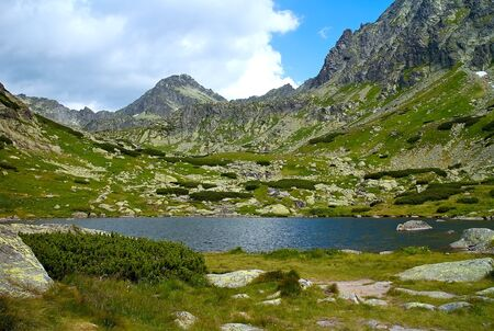 Lake above the Skok waterfall - hiking in the Mlynicka valley in the High Tatras. Beautiful Slovakia.