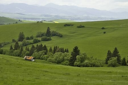 Farm building for sheep breeding in the beautiful surroundings of the Liptovska Mara dam. Stock Photo