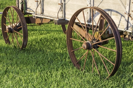 Side view of 2 metal wagon wheels from an old stagecoach from the 1800s  photo