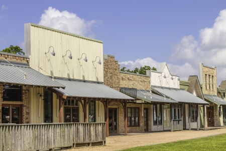 A row of old western rural shops with a bright blue sky in the background. photo
