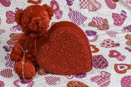 A red bear and heart create a colorful Valentines Day theme. photo