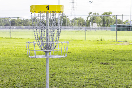 A shot of the first hole of a disc golf course.