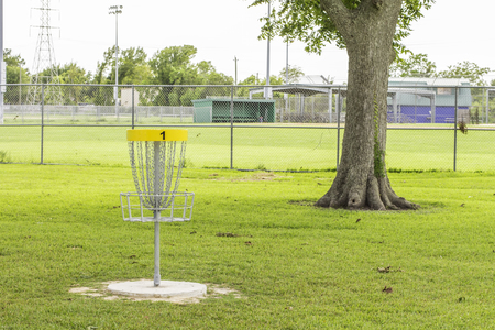 disc golf: A shot of the first hole of a disc golf course.