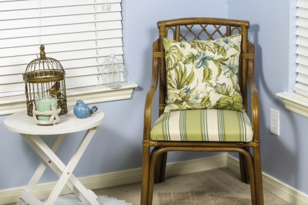 sunroom: A coastal themed indoor shot of a wicker chair.