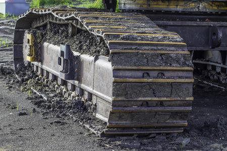 A close shot of the rotating tracks of excavator equipment. photo