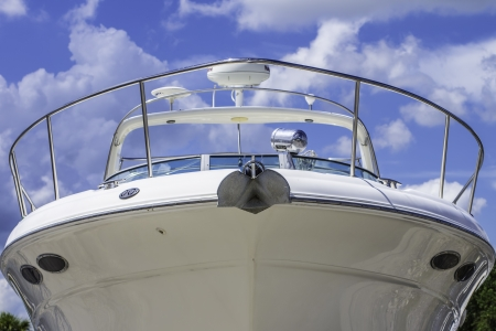A large white boat shot of the front of the bow. photo