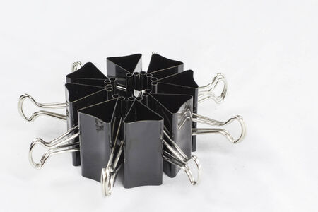 A group of binder clips arranged in a circular pattern. Фото со стока - 22797898