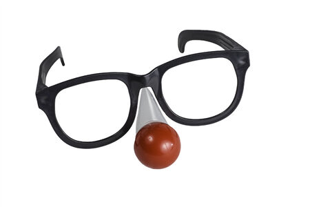 over sized: An over sized pair of eye glasses with a red nose isolated on a white .