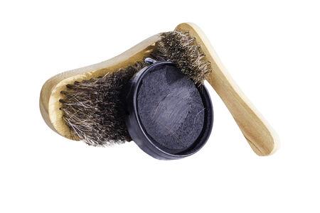 Schoenpoets borstels en blikje zwarte nagellak. Stockfoto