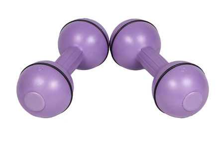 A pair of ladies dumbbells sitting next to each other isolated on a white.