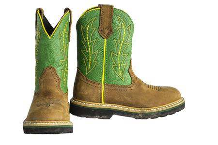 A pair of brown and green cowboy work boots isolated on a white.